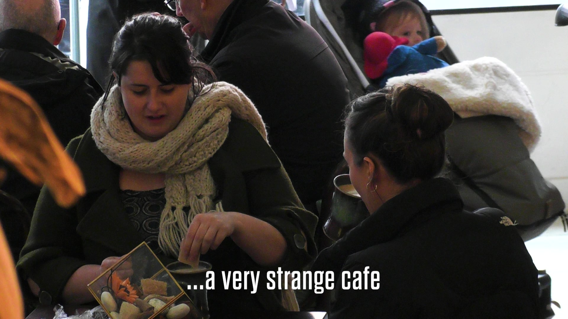 MSUnderstood café advertising Multiple Sclerosis with woman saying this is a very strange cafe
